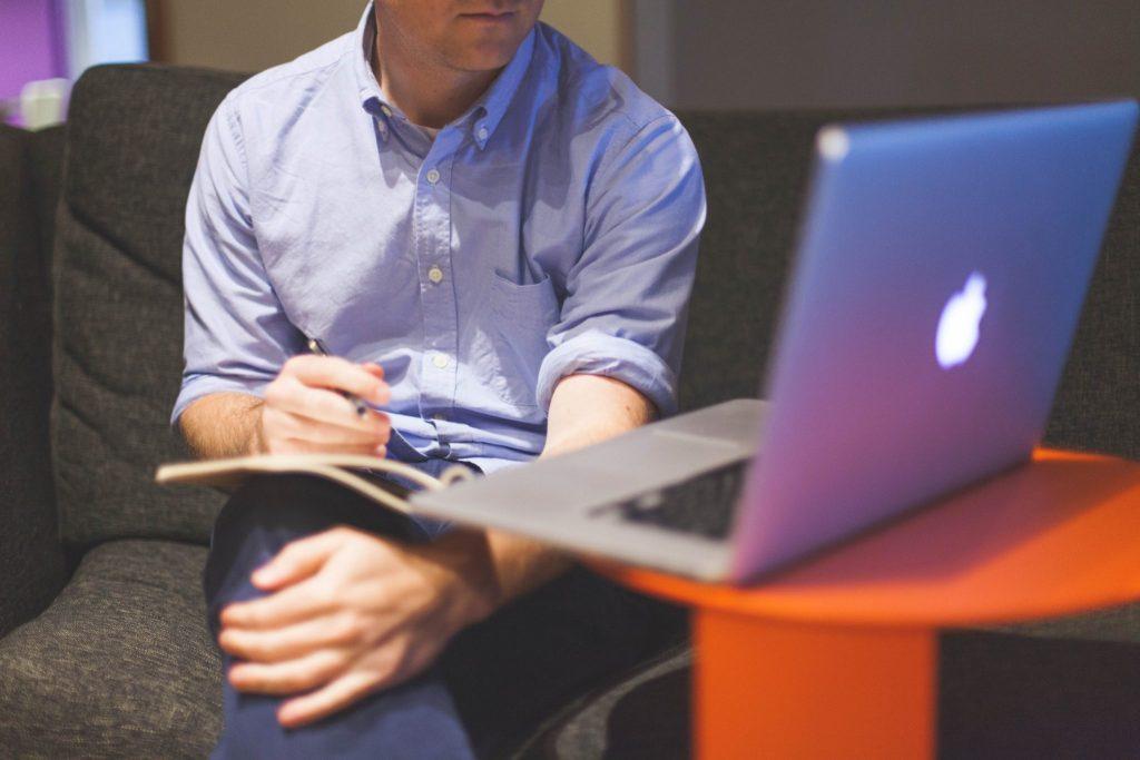 man working on a laptop Ardea International - Modern Slavery   Human Rights   Sustainability