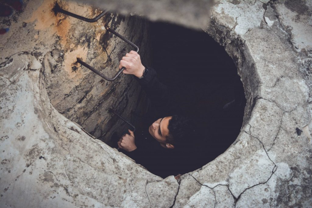 Man down a hole Ardea International - Modern Slavery | Human Rights | Sustainability