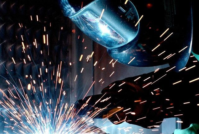 Man welding – Sustainability, ethics and compliance business support packages